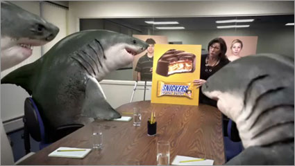 AdFreak: Hungry sharks enjoy Snickers-filled humans